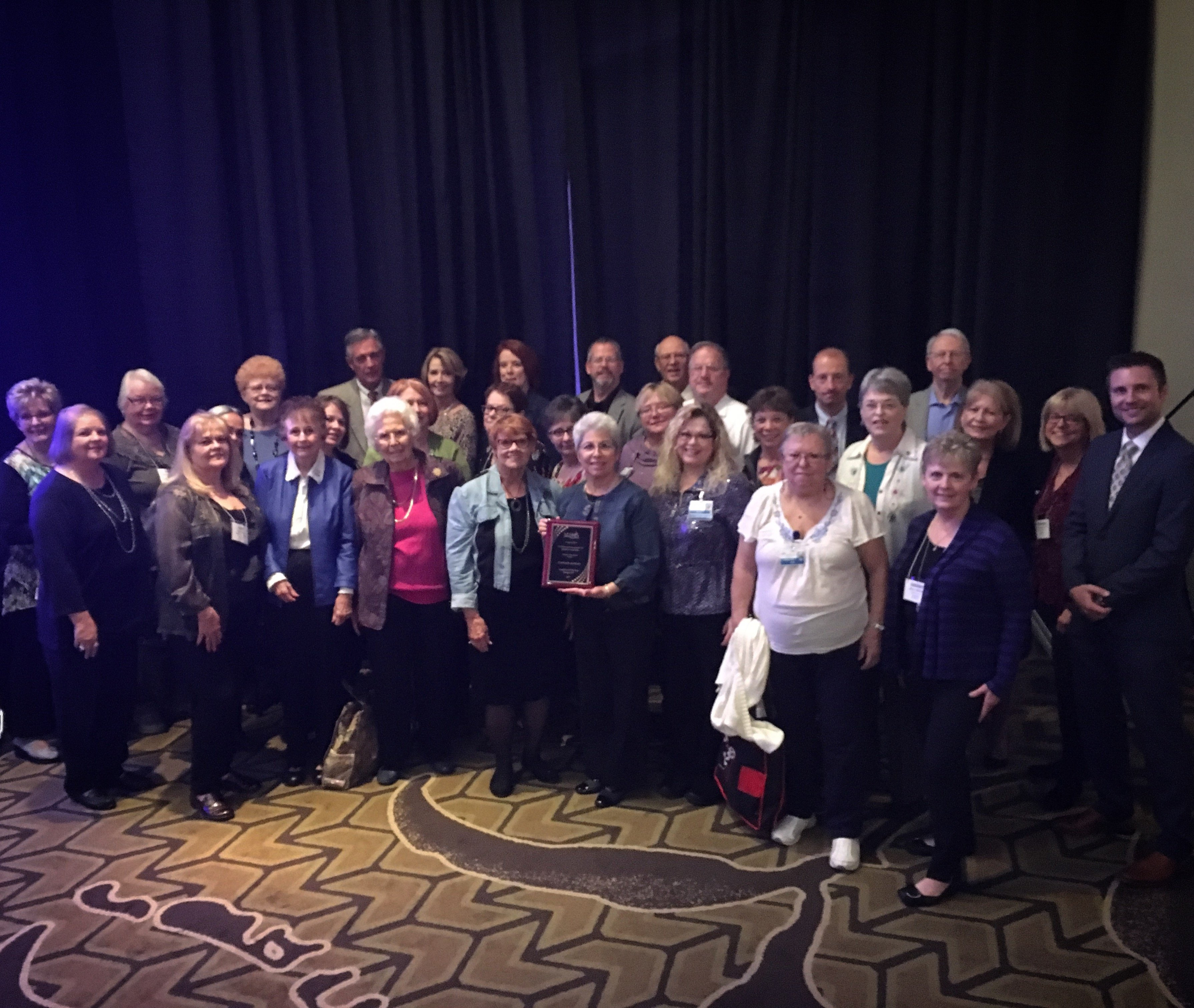 A group of CoxHealth Auxiliary members pose at a convention.