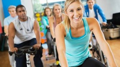 CoxHealth Fitness Center members enjoy an indoor cycling class.