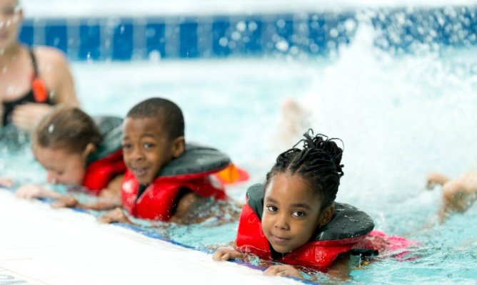 Children participate in swimming lessons at CoxHealth Fitness Centers.