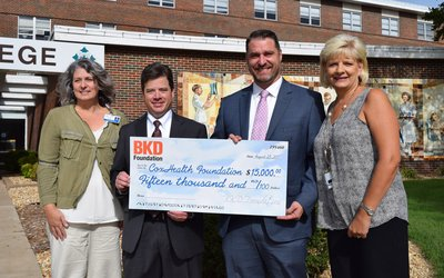 Dr. Amy DeMelo, president of Cox College; Eddie Marmouget, national industry partner for BKD's health care practice; Andy Williams, partner in BKD's health care practice; and Lisa Alexander, president of the CoxHealth Foundation hold a $15,000 check.