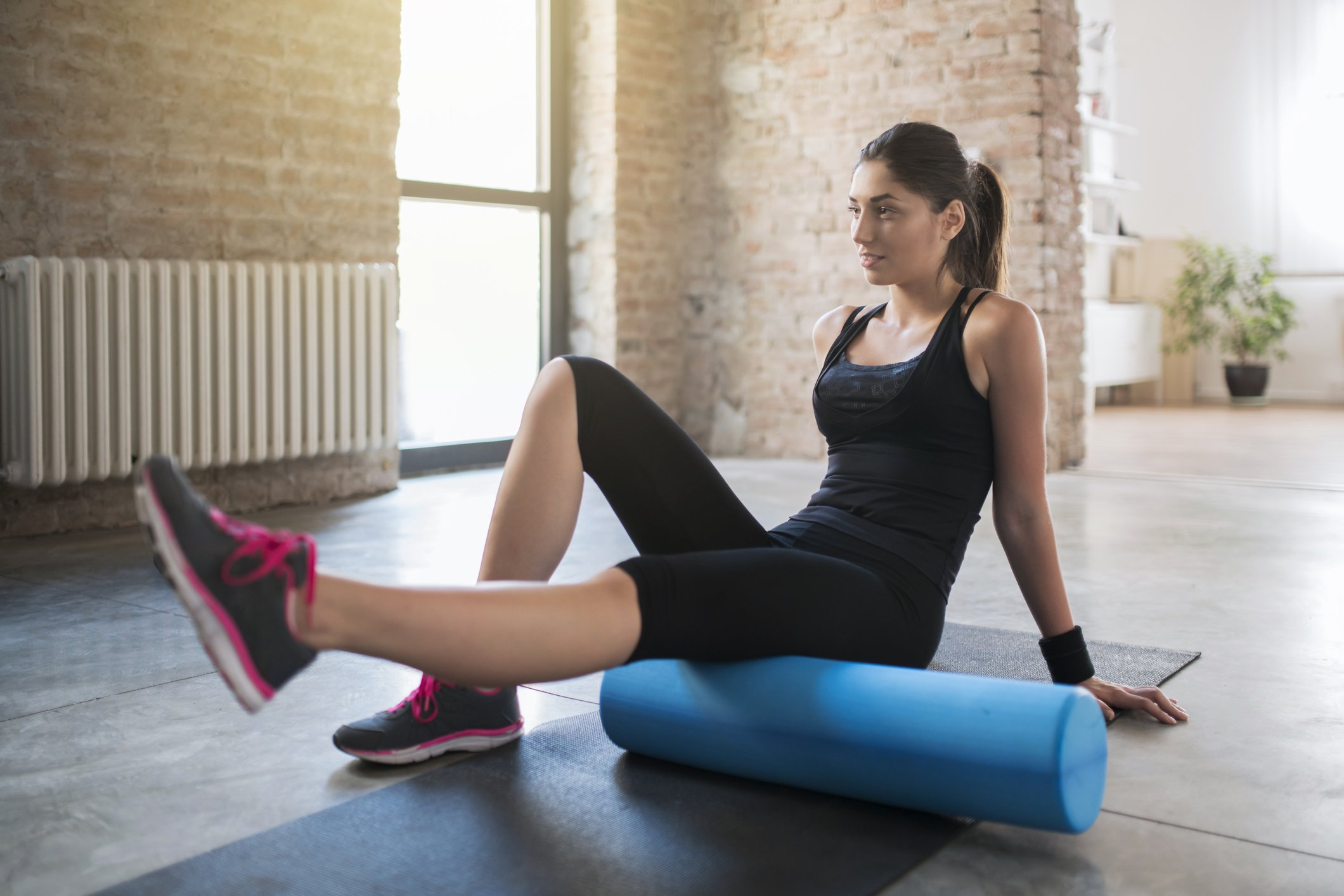 A woman learn how to use a foam roller for pain relief at CoxHealth's Foam Roller Workshop.