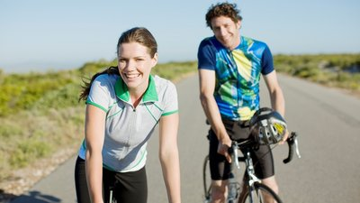 Active employees riding bikes benefit from CoxHealth's express login to access their healthy living portal.