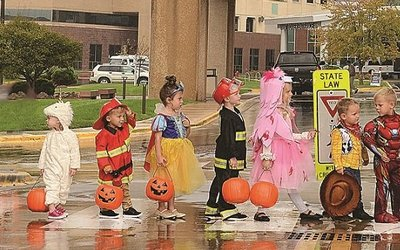 Kids trick-or-treat at Cox South in costumes.